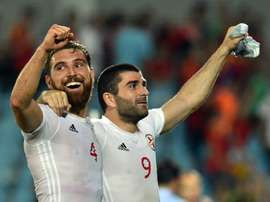 Georgias defender Guram Kashia (L) and midfielder Jano Ananidze celebrate their 1-0 victory at the end of the Euro 2016 friendly vs Spain in Getafe, on June 7, 2016