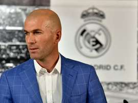 Real Madrids new French coach Zinedine Zidane poses after a statement made by the clubs president, at Santiago Bernabeu stadium in Madrid, on January 4, 2016