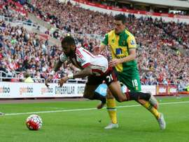 Norwich Citys Scottish midfielder Graham Dorrans (R) tackles Sunderlands French midfielder Yann MVila during the English Premier League football match at the Stadium of Light in Sunderland, north east England on August 15, 2015