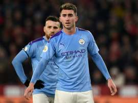 Laporte will play v Real Madrid, says Guardiola. AFP
