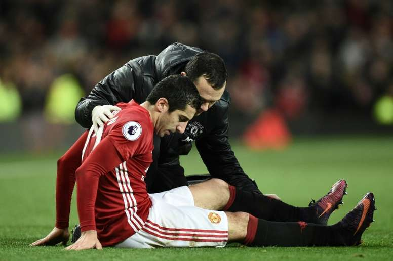 Manchester United midfielder Henrikh Mkhitaryan receives attention after picking up an injury. AFP