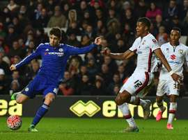 Chelseas midfielder Oscar (L) shoots to score his third goal during the English FA Cup fourth round football match between MK Dons and Chelsea at Stadium MK in Milton Keynes, England, on January 31, 2016
