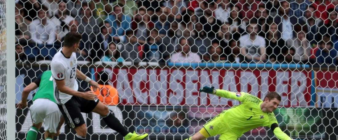Northern Irelands goalkeeper Michael McGovern stops a goal attempt by Germanys forward Mario Gomez during the Euro 2016 group C football match between Northern Ireland and Germany at the Parc des Princes stadium in Paris on June 21, 2016.