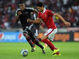Orlando Pirates Thamsanqa Gabuza (L) vies with Al Ahlys Mohamed Naguib during the first semi final of the 2015 CAF - Confederation of African Football Cup on September 26, 2015 at the Orlando Pirates Stadium in Johannesburg, South Africa