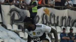 Adebayor (top) made his Olimpia debut on Sunday. AFP