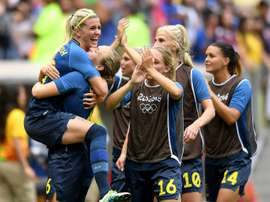 Swedens footballers celebrate victory over the US during the Rio Olympics quarter-finals match on August 12, 2016