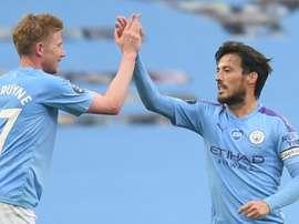 Kevin de Bruyne (L) says David Silva's (R) departure will be a big loss for Man City. AFP