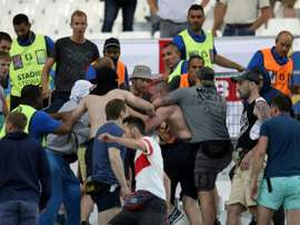 Groups of supporters fight at the end of the Euro 2016 match between England and Russia. BeSoccer