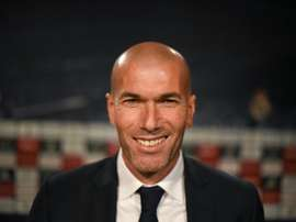 Real Madrids new coach Zinedine Zidane (L) poses before a press conference at the Santiago Bernabeu stadium in Madrid on January 5, 2016