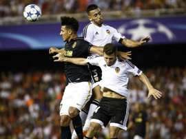 Monaco's Moroccan midfielder Nabil Dirar (R) vies with Valencia's Portuguese defender Ruben Vezo (C) and Spanish defender Jose Gaya during the UEFA Champions League playoff football match in Valencia on August 19, 2014