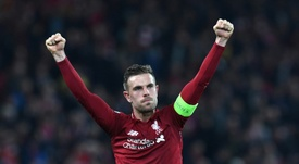 Henderson pays tribute to returning Liverpool star Oxlade-Chamberlain. AFP