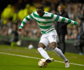 Dembele gave Celtic a two goal cushion before the red card. AFP