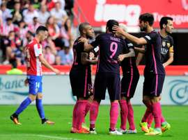 Rafael Alcantara is congratulated by teammates after scoring a goal against Sporting de Gijon. AFP