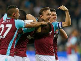 West Ham's Edimilson Fernandes (C) celebrates with teammates after scoring against Chelsea. AFP
