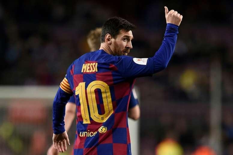 Puyol ve a Messi jugando hasta los 38 años. AFP