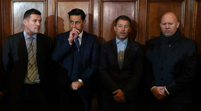 Former footballers and victims of abuse (from L) Mark Williams, Andy Woodward, Steve Walters and Jason Dunford, seen ahead of a press conference in Manchester, on December 5, 2016