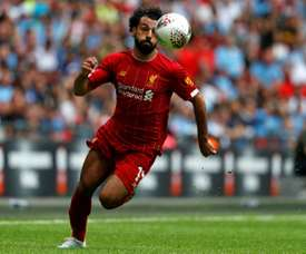 Salah will be out injured for the return of the Premier League. AFP/Archivo