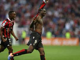 Nices forward Mario Balotelli (R) celebrates after scoring a goal with his teammate Wylan Cyprien on October 2, 2016