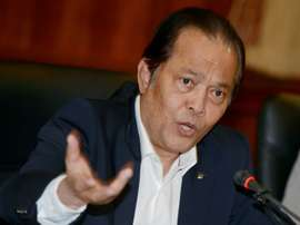 Thai football executive Worawi Makudi answers questions during a 2012 press conference in Bangkok