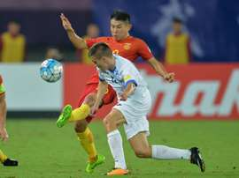China's Yu Hanchao in action against Uzbekistan. AFP