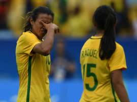Brazil players Marta (left) and Raquel Fernandes leave the field in dejection after losing to Sweden in their womens football semi-final against Sweden at the Maracana Stadium on August 16, 2016