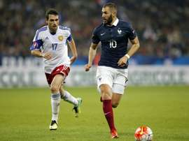 Frances forward Karim Benzema (R) vies for the ball with Armenias midfielder Artur Yuspashyan during the friendly football match on October 8, 2015 at the Allianz Riviera stadium in Nice, southeastern France