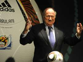 FIFA President Sepp Blatter posing with Jabulani the official Adidas match ball for the 2010 World Cup during the handover event in 2009