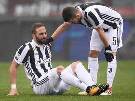Higuain, Bernardeschi blow for Juventus in bruising derby win. AFP