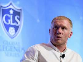 Paul Scholes has earmarked their rival's top stars as players his side are missing. AFP