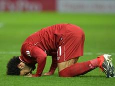 Salah celebrates scoring against Watford. AFP