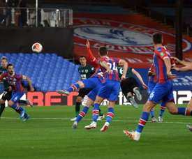 Mee winner at Palace fires Burnley into eighth