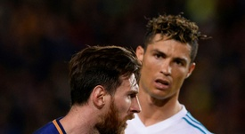 Ronaldo wants to surpass Messi, according to Giggs. AFP
