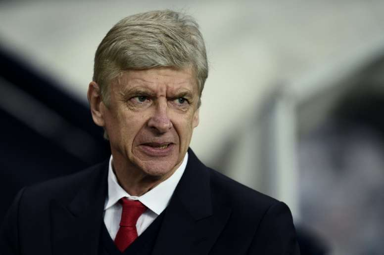 Wenger was left upset by both of Man City's goals. AFP