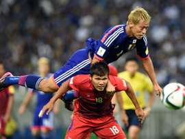 Keisuke Honda (top) scored a first half goal to help Japan towards a 3-0 win over Singapore
