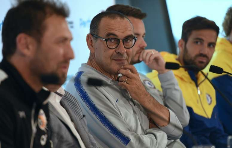 Fabregas says Sarri is very stuck in his ways. AFP