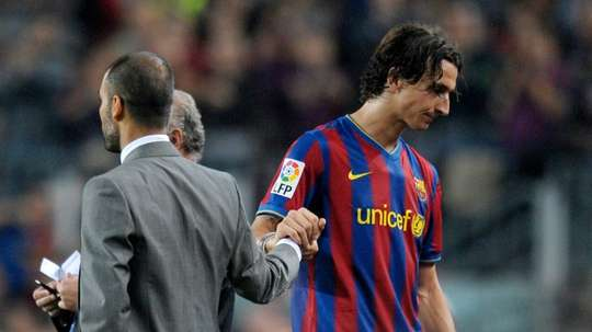 Pep Guardiola (left) managed Zlatan Ibrahimovic (right) at Barcelona. AFP
