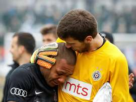 Partizan Belgrades goalkeeper Filip Kljajic (R) hugs Brazilian midfielder Everton Luiz as he leaves