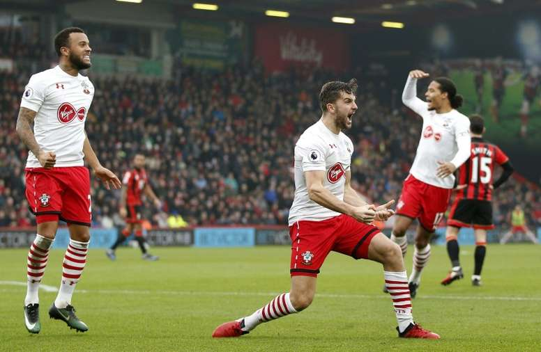 Jay Rodriguez (C) celebrates scoring his team's second goal against Bournemouth. AFP
