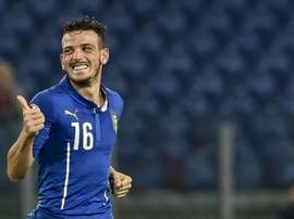 Italys midfielder Alessandro Florenzi celebrates after scoring during the Euro 2016 qualifying football match between Italy and Norway at Romes Olympic stadium on October 13, 2015