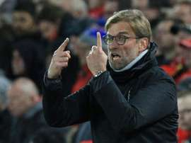 Liverpool's manager Jurgen Klopp holding up his fingers. AFP