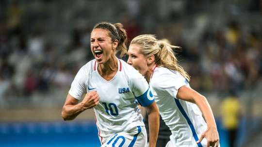 Carli Lloyd (L) of the USA celebrates her goal during a Rio Olympics match against New Zealand on August 3, 2016