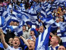 QPR fans cheer for their team during a match at Wembley Stadium in London on May 24, 2014