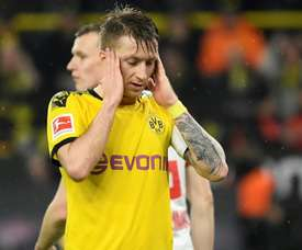 Marco Reus will miss around four weeks of action. AFP