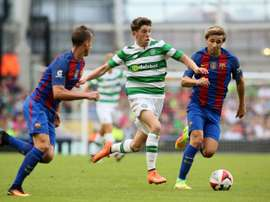 Ryan Christie (C) has held talks with Celtic over a new contract. AFP