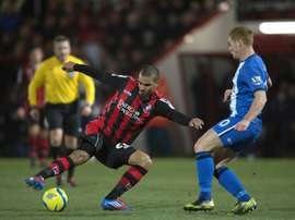 Lewis Grabban (C) vies for the ball during a match between Bournemouth and Wigan Athletic on January 15, 2013