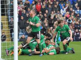 Lincoln Citys Sean Raggett celebrates with teammates. AFP