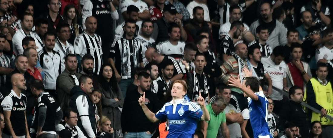 Dynamos Viktor Tsygankov (L) celebrates with teammate Mykola Mozozyuk after scoring a goal. AFP