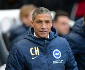 Hughton watched the striker play against Aston Villa last week. AFP