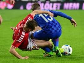 Croatias Domagoj Antoli‡ (R) vies with Hungarys Mihaly Korhut (L). BeSoccer