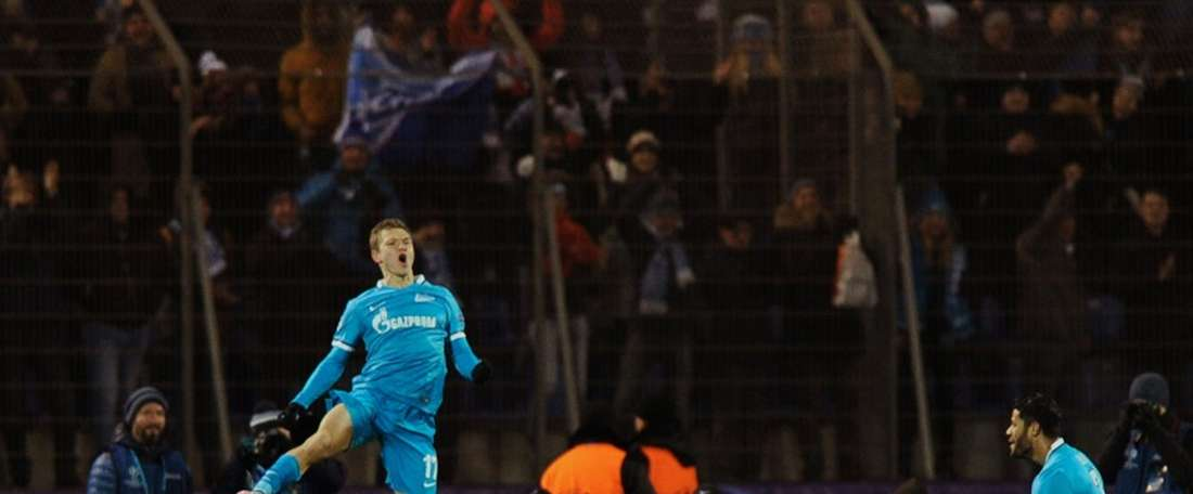 Zenits Russian midfielder Oleg Shatov celebrates after scoring during an UEFA Champions League match against Valencia at the Petrovsky stadium in St Petersburg on November 24, 2015